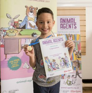 Summer Reading Challenge 2017 (Animal Agents) photos of kids with branded materials 3 resize